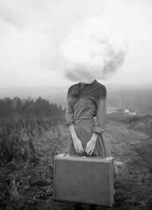 woman with head in clouds